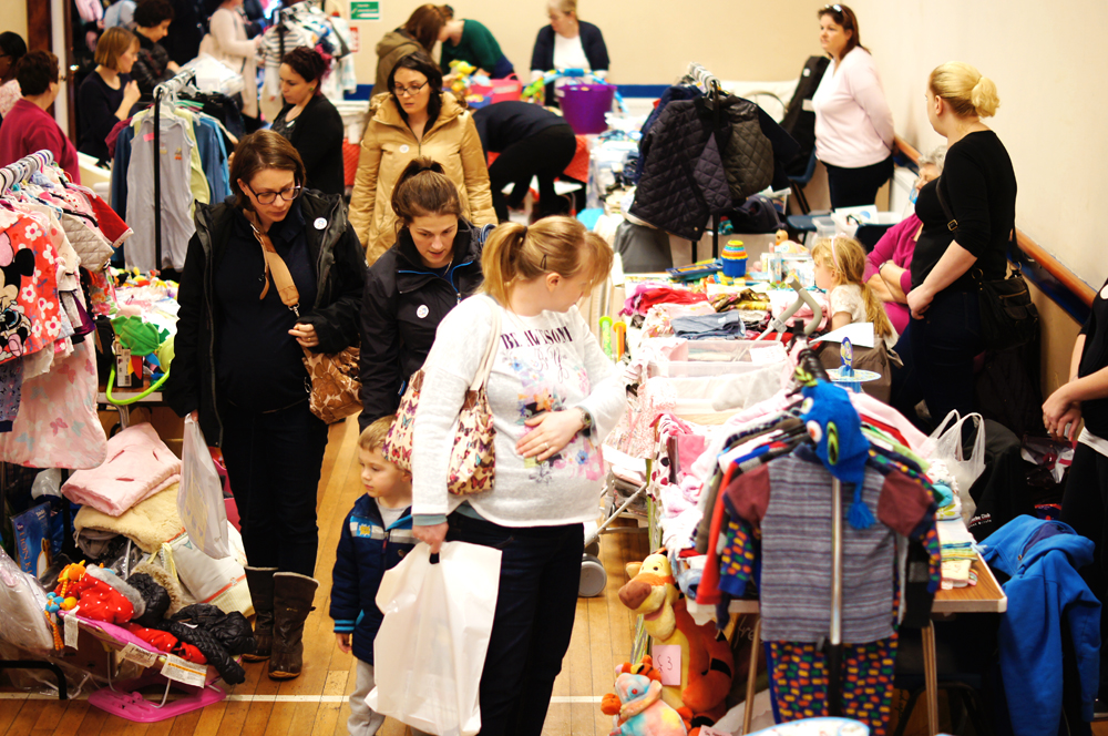 Picture: Busy shoppers at the New Haw mum2mum market nearly new sale in Surrey